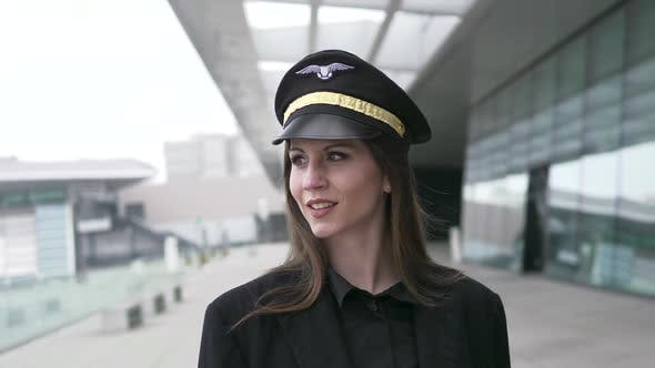 Thumbnail for Young Attractive Woman Captain Officer Working for Airline at Terminal