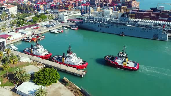 Aerial Footage of Tugboats at Sea Cargo Logistics Terminal Harbor