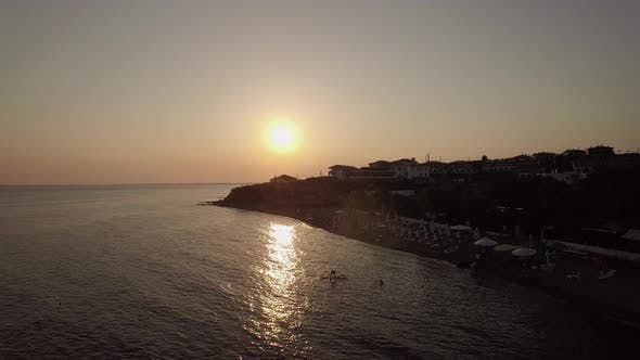 Thumbnail for Aerial Scene of Resort and Sea at Sunset. Trikorfo Beach, Greece