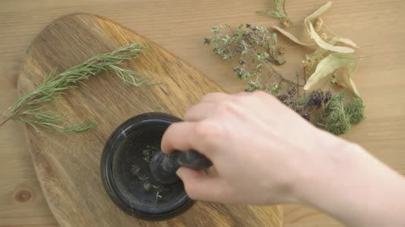 Hands Rubbed The Herbs in a Mortar