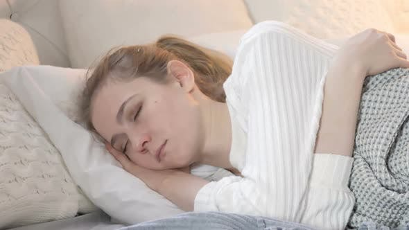 Thumbnail for Young Woman Sleeping in Bed