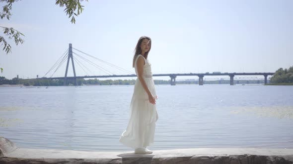Thumbnail for Portrait Glamorous Young Girl with Long Brunette Hair Wearing a Long White Summer Fashion Dress