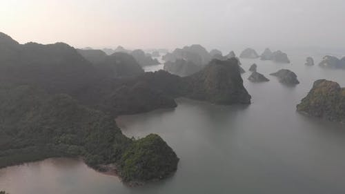 Aerial: unique flying over Ha Long Bay and Cat Ba island at sunset Vietnam