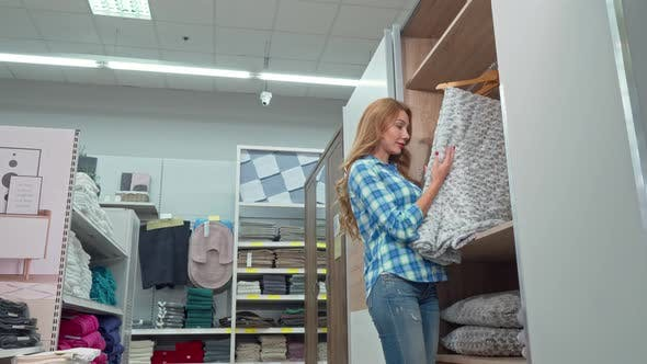 Thumbnail for Beautiful Woman Smiling To the Camera, Buying a Blanket at Furnishings Store