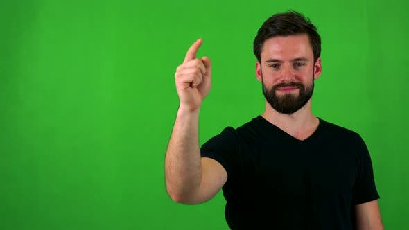 Thumbnail for Young Handsome Bearded Man Points To Camera with Finger - Green Screen - Studio