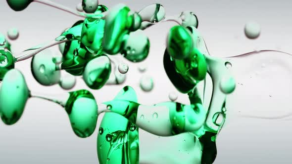 Thumbnail for Transparente kosmetische grüne Petroöl Blasen und Formen auf weißem Hintergrund