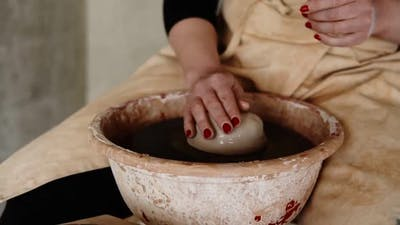 Female Artist Potter in the Workshop Creating a Ceramic Product