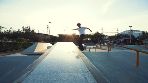 Thumbnail for Young Man Skateboarding At Sunset