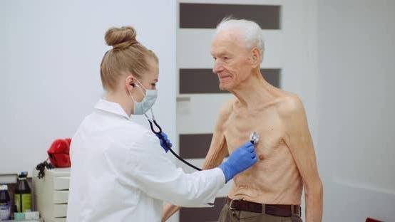 Thumbnail for Female Doctor Examine Elderly Man with Stethoscope