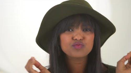 Black girl wearing floppy hat