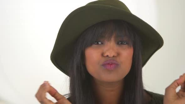 Thumbnail for Black girl wearing floppy hat