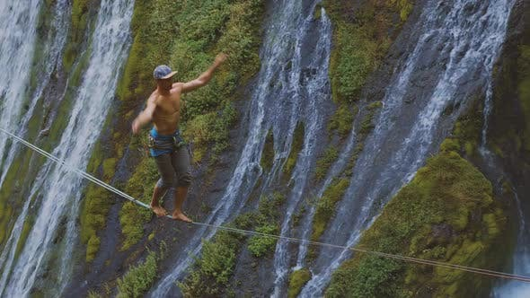 Thumbnail for Fit Man High-lining Over A Waterfall