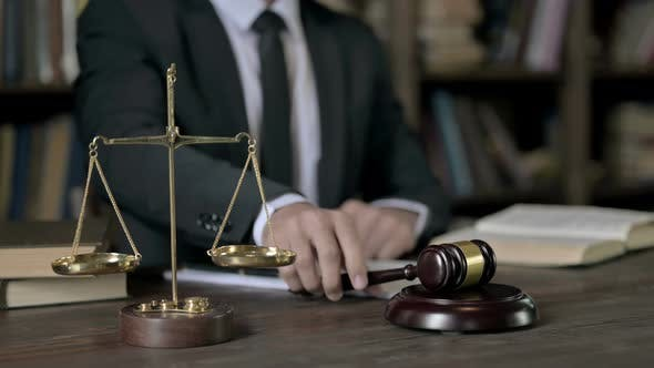 Thumbnail for Close Up Shoot of Judge Hand Banging the Gavel on Court Room Table