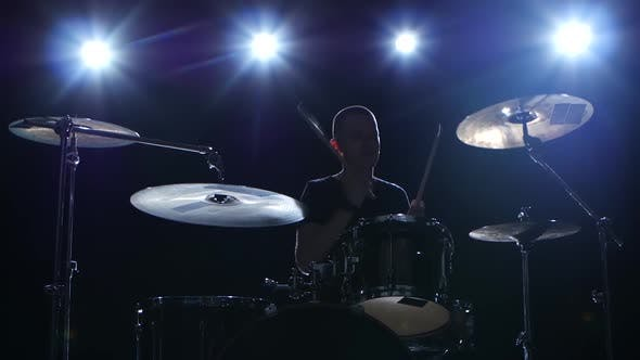 Thumbnail for Drummer Plays the Melody on the Drums Energetically. Black Background, Back Light, Silhouette