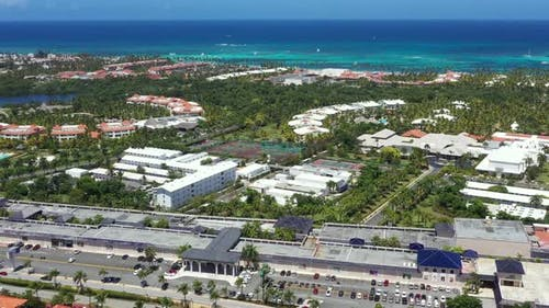 Caribbean City Near Tropical Coastline. Aerial View From Drone