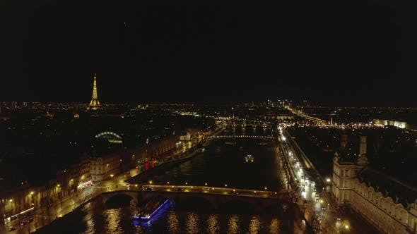 Cover Image for AERIAL: View Over Seine River at Night in Paris, France with View on Eiffel Tower, Tour Eiffel