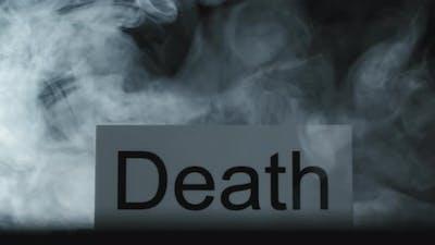 Smoke Flowing Around Word Death