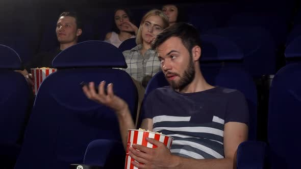 Thumbnail for Man Talking on His Phone at the Movie Theatre