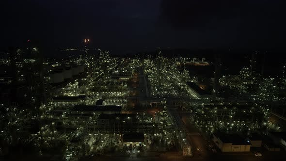 Cinematic Aerial Drone Night Shot Oil refinery petrochemical Plant Complex