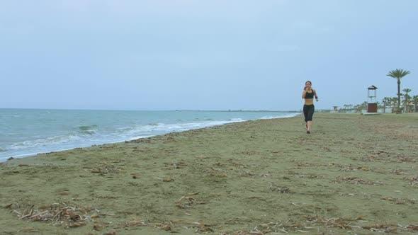 Thumbnail for Female Athlete Training at Seaside, Running on Sandy Beach. Success Motivation