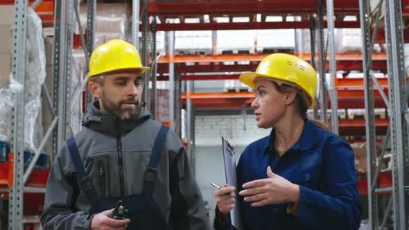 Cover Image for Workers Talking and Walking through Warehouse