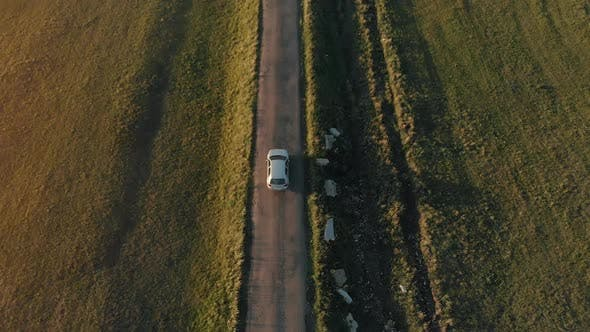 Thumbnail for Aerial View of a Car Driving on Country Road
