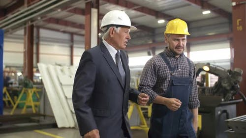 Executive and Engineer Inspecting Factory Premises
