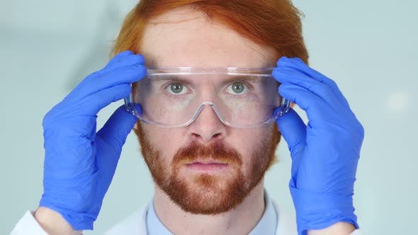 Thumbnail for Redhead Scientist, Doctor Wearing Protective Glasses
