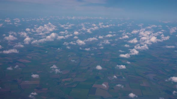 Thumbnail for Spectacular View From Plane on Earth with Tiny Fields and Woods.