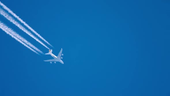 Plane Trail in the Blue Sky