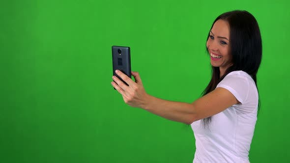 Thumbnail for Young Pretty Woman Photographs with Smartphone (Selfie) - Green Screen - Studio