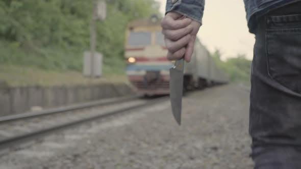Thumbnail for Maniac with a Knife Near the Railway Tracks.