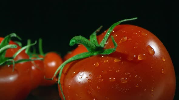 Macro Shot Of Tomato With Water Drops