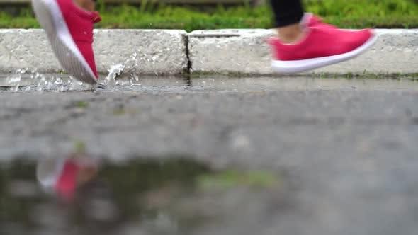Legs of a Runner in Sneakers