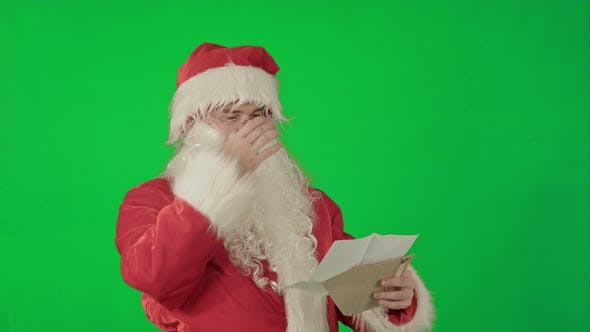 Cover Image for Santa Claus Reading Letters From Children on a Green Screen Chrome Key