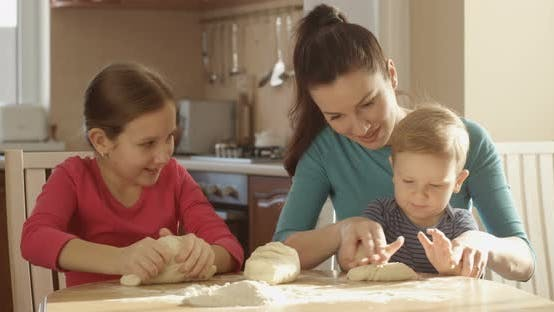 Thumbnail for Happy Family Having Fun Time Cooking Together Pancakes Kneading Dough Mother Teaching Children