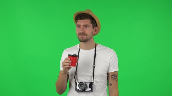 Thumbnail for Portrait of Confident Guy Is Enjoying Coffee