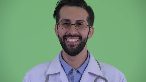 Cover Image for Face of Happy Young Bearded Persian Man Doctor Smiling