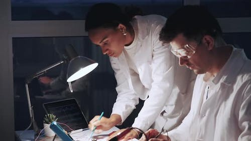 Close Up of African American Woman and Man in Protective Glasses Working in Modern Electronics