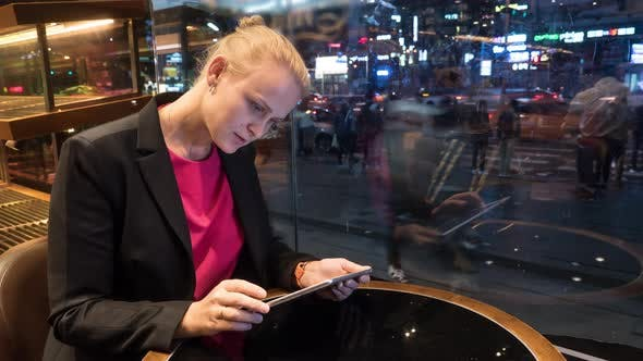 Cover Image for Time Lapse Shot of Woman Sitting in Cafe Using Touch Pad on the City Background. Seoul, South Korea