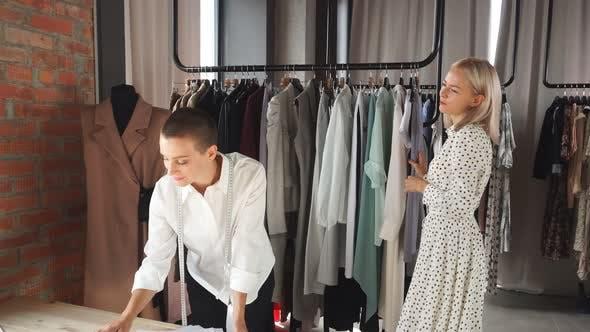 Clothes Designer Show Her Handmade Clothes To Customer