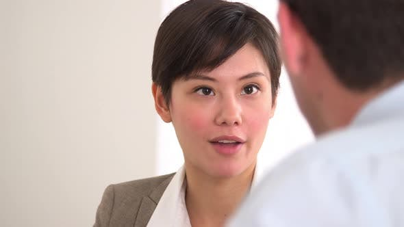 Thumbnail for Happy Asian businesswoman talking in a meeting