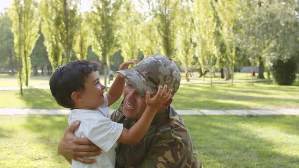 Excited Kid Running to Military Dads Open Arms