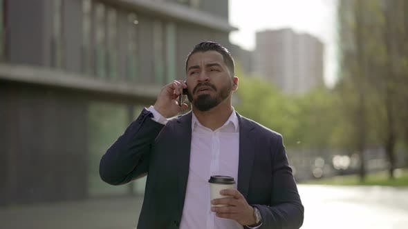 Thumbnail for Man Talking By Smartphone and Drinking From Paper Cup Outdoor
