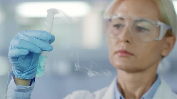 Thumbnail for Female Chemist Working in Lab