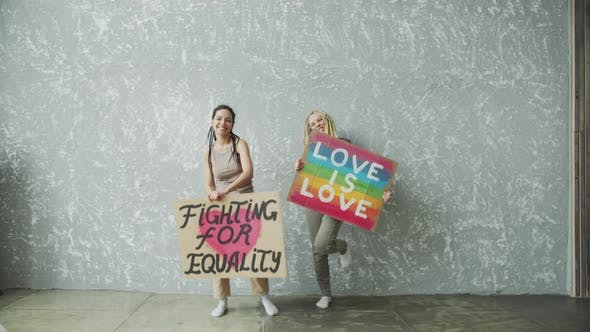 Super Funny Dancing Girls with LGBTQ Posters
