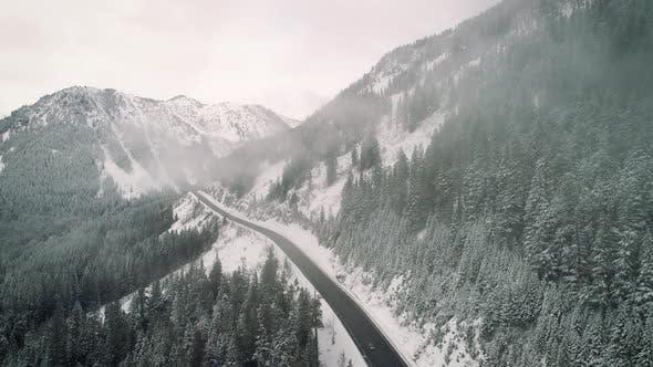 Snowy Mountain Highway Aerial Cloud Hyperlapse