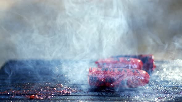 Sausage In Smoke On Barbecue Fire