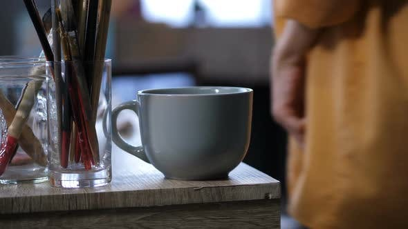 Thumbnail for Coffee Cup and Artistic Equipment on Work Table