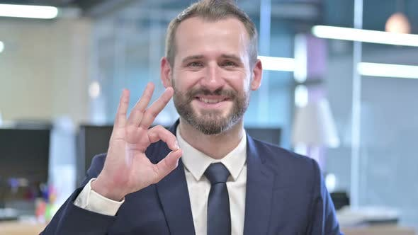 Thumbnail for Portrait of Cheerful Businessman Showing Ok Sign in Office